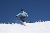 Snowboarder jumping in the mountains